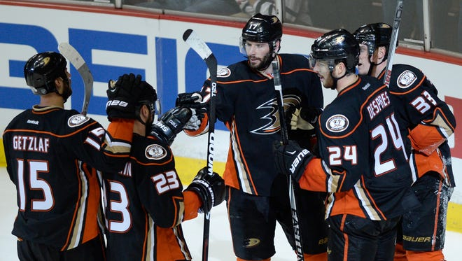 Anaheim Ducks right wing Jakob Silfverberg (33) celebrates with teammates after scoring an open net goal against the Chicago Blackhawks during the third period in game one of the Western Conference Final of the 2015 Stanley Cup Playoffs at Honda Center.