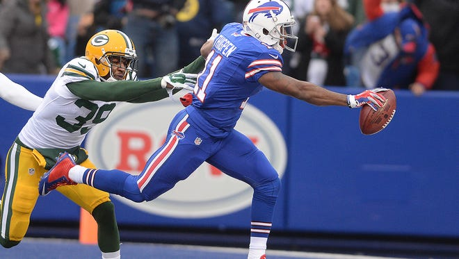 Green Bay Packers special teams player Demetri Goodson (39) arrives too late to stop Marcus Thigpen (11) from scoring on a punt return against the Buffalo Bills at Ralph Wilson Stadium in Orchard Park, N.Y., December 14, 2014.