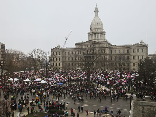 Crowds gather outside the State Capitol Sunday, Jan.