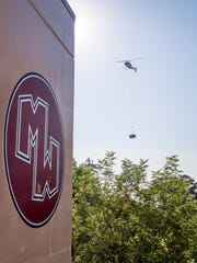 A helicopter was used Tuesday, July 17, 2018 to place 13 new air conditioning units on classrooms at Mt. Whitney High School.