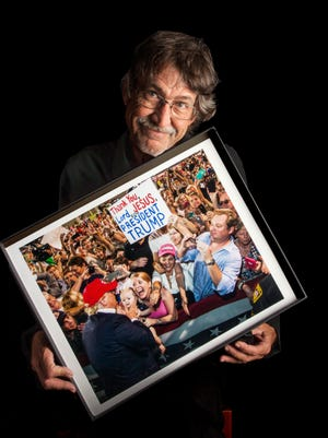 Mark Wallheiser poses with the photo he took of Donald Trump at a rally in Mobile, Alabama. The photo has garnered international attention, and was recently purchased for the Sir Elton John Photographic Collection.