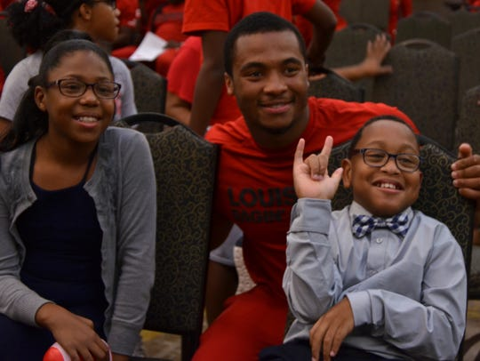 UL running back Elijah Mitchell poses with his cousin,