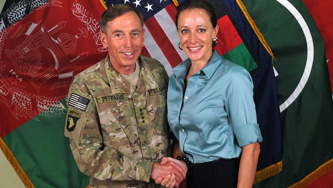 Davis Petraeus, left, shaking hands with Paula Broadwell, his biographer and mistress, in 2011.