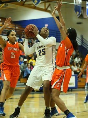 Tupelo's Alayjah Sherer (25) gathers to shoot during its win over Southaven on Friday.