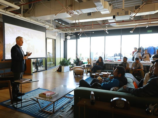 Photographer John Moore speaks at a WeWork space in