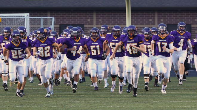 Johnston players enter the stadium as a group during their home game against Southeast Polk earlier this season.