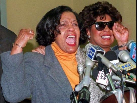 Myrlie Evers (left) and her daughter, Reena, cheer