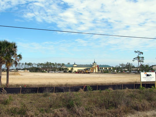 The acreage recently cleared next to the New Hope Ministry