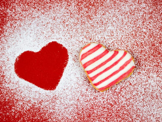 Powdered sugar heart shaped cookies