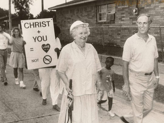 Virginia Shehee takes part in a community march through Cedar Grove, an anti-drug effort organized by comedian and activist Dick Gregory in August 1989.