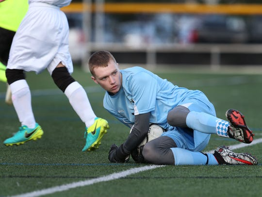 Churchville-Chili goalie, Alex Voglewede, makes a save