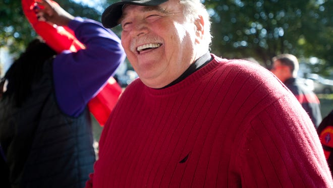 Former high school football coach Bobby Redman is all smiles as he talks to his former players at Camp Taylor's Memorial Park. Redman is running as a Republican in the predominantly Democratic Louisville Metro Council District 10 and the players volunteered to help him campaign.