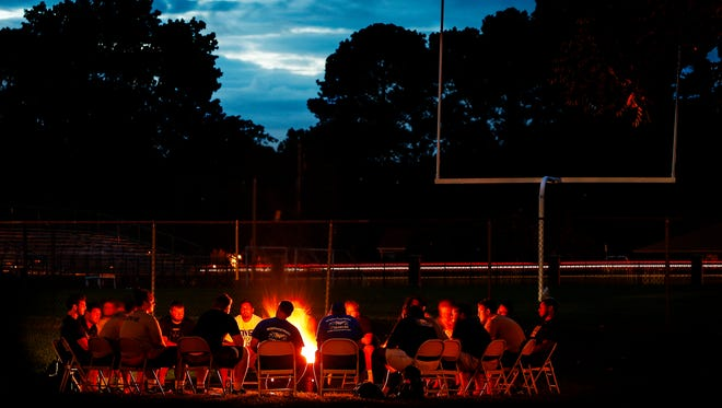 August 11, 2016 - University of Memphis teammates take part in a campfire, giving players the chance to tell each other heartfelt stories about themselves, during preseason training camp on the Lambuth Campus in Jackson, Tenn.  (Mark Weber/The Commercial Appeal)
