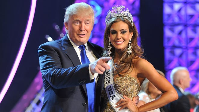 Donald Trump, left, and Miss Connecticut USA Erin Brady onstage after Brady won the 2013 Miss USA pageant in Las Vegas, Nev., in June 2013.