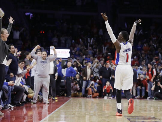 Detroit Pistons guard Reggie Jackson raises his arms during the closing seconds of the team's NBA basketball game against the Oklahoma City Thunder, Tuesday, March 29, 2016, in Auburn Hills.