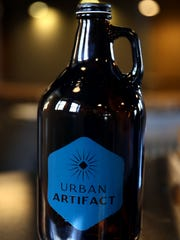 A growler by Urban Artifact Brewing in Northside.