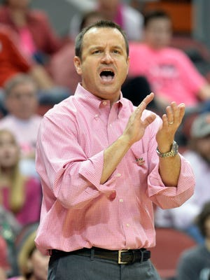 Louisville's head coach Jeff Walz applauds his team's effort during the second half of their NCAA college basketball game against North Carolina, Sunday, Feb. 19, 2017 in Louisville Ky. Louisville won 87-57.