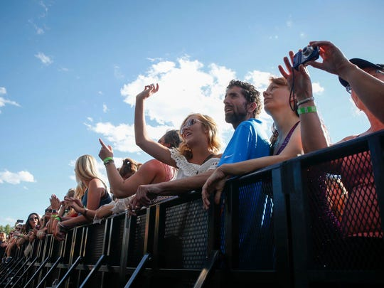 Country music fans cheer during the Big Country Bash concert festival at Living History Farms on Sunday, June 25, 2017.