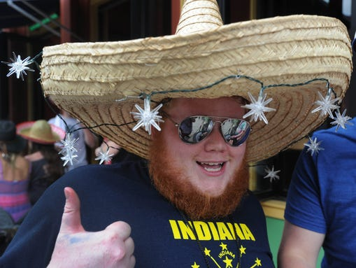 This was at Tiki Bob's.  A bar crawl between 10 downtown bars was a way to celebrate both Cinco de Mayo and the Kentucky Derby. The afternoon event Saturday May 3, 2013 took place at Taps & Dolls: 247 S Meridian St, TilleryÕs: 235 S Meridian St, Tiki BobÕs: 231 S Meridian St, Cadillac Ranch: 39 W Jackson Pl, KilroyÕs: 201 S Meridian St, Tilted Kilt: 141 S Meridian St, Hard Rock Caf?: 48 S Meridian St, Adobo: 110 E Washington St, Tin Roof: 36 S Pennsylvania St and The Pub: 30 E Georgia St. Rob Goebel/The Star