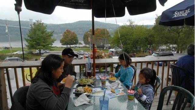 Ekapat and Sue Chareonlarp of Campbell Hall, N.Y., eat lunch at River Station in Poughkeepsie with their daughters, Arya, 8, and Davini, 4. They came to visit the Children's Museum but stayed for the festival Saturday.