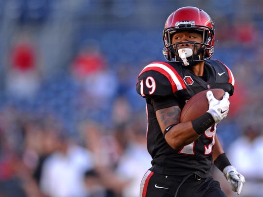 San Diego State Aztecs running back Donnel Pumphrey (19) runs for a touchdown during the third quarter against the San Jose State Spartans at Qualcomm Stadium.