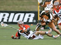 Denver's Tim Barber (16) is checked to the ground by Rattlers Donny Moss.
