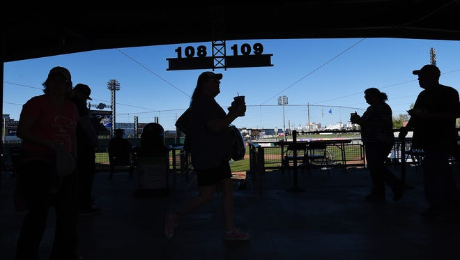 Fans get their refreshments and find their seats during opening day at Aces Ballpark in Reno in April 17, 2015.