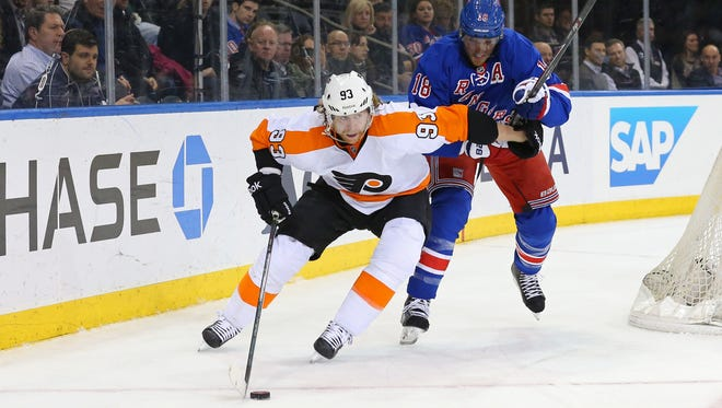 Philadelphia Flyers right wing Jakub Voracek, battling New York Rangers defenseman Marc Staal, has lost his last eight visits to Madison Square Garden.