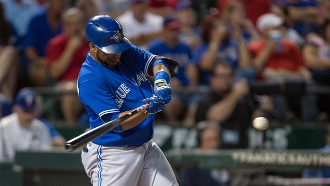 Blue Jays designated hitter Edwin Encarnacion hits a grand slam against during the sixth inning at Globe Life Park in Arlington.