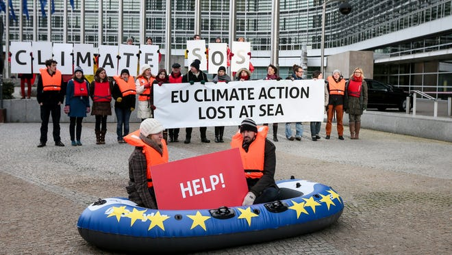 Global warming activists protest in front of the European Commission headquarters in Brussels in January.