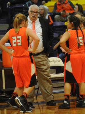 Robert Lee coach Billy Whyburn talks to Samantha Roe (23) and Anna Huapilla (15) in a break late in a 2017 playoff game against Rotan.