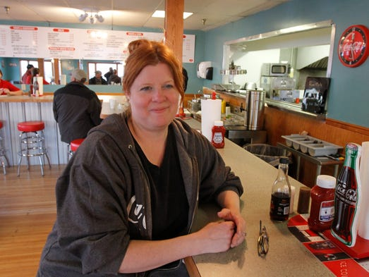 Michelle Danielowicz sits at the counter of Vic's Place,
