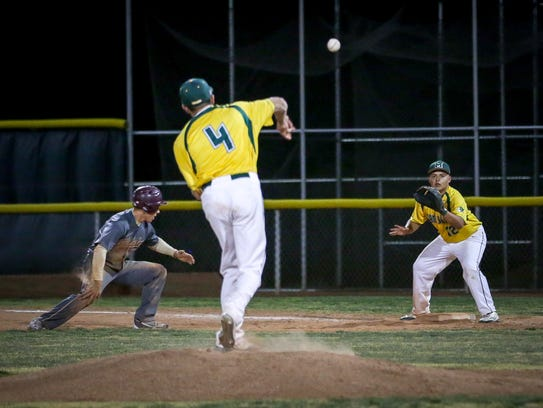 Mayfield pitcher Ethan Alvarado (4) throws to first