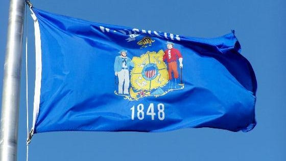 The words and symbols of Wisconsin's state flag are hard to see from far away.