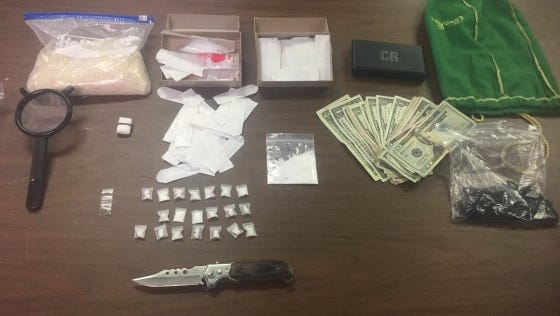 Police founds drugs and drug paraphernalia inside the vehicle