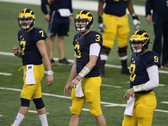 """Quarterbacks, from left, Morris, Wilton Speight and John O'Korn go through practice drills. """"I've become a much happier person,"""" Morris says of his maturity."""