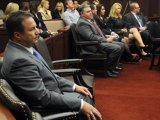 Eddie Lorton, left, sits in the Nevada Supreme Court Tuesday Jan. 21, 2014 along with Dwight Dortch, in gray suit and red tie and Jessica Sferrazza.
