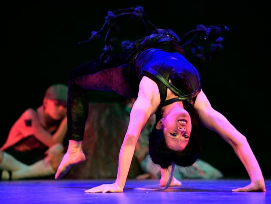 """Leilaine Tibbitts spider-crawls upside-down onto the stage at Hardin-Simmons University during a forest scene Friday during the Dance, Ltd.-School of Dance spring show. """"Gala Performance & Hansel and Gretel"""" featured nearly 60 students of varying ages."""