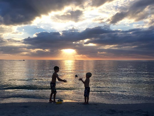 """Gale and Jim Mix submitted this photo, writing, """"This is a picture of our grandsons James and Benjamin at the Bonita Bay beach at sunset. They were visiting us over the Thanksgiving holiday."""