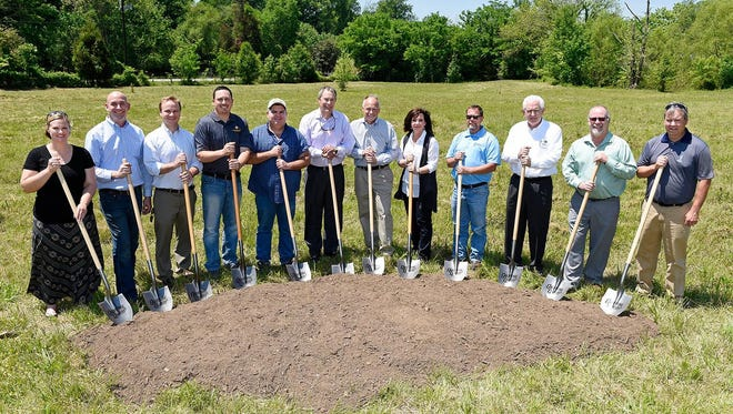 Present at the ground breaking: Keli Frymire and Greg Gamble, Gable Design Collaborative; Adam Seger, Dale and Associates; Chris Jaco, Changing Seasons Property Maintenance; Tim Humerick, Humerick Construction; Cory Napier, Mayor of Thompson's Station; Rick and Nancy McEachern, Owners Graystone Quarry Events; Mark Tarrh, Project Manager RSU Contractors; Arlen Harris, Pinnacle Financial Partners; William Johnson, Architect; and Clay Beach with Miller, Loughry and Beach.