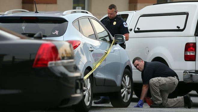 Cobb County police investigate an SUV where Cooper Harris died near Marietta, Ga., on June 18.