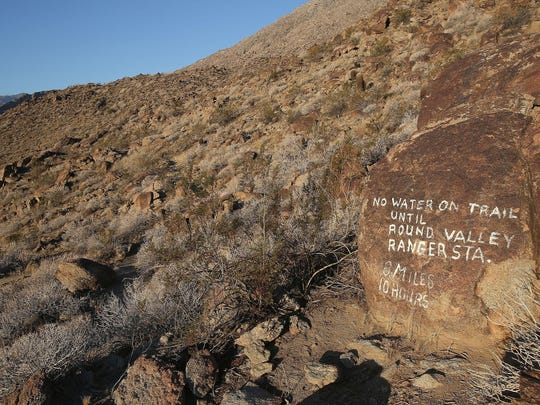 A painted rock tells hikers how far it is to Long Valley on the Skyline Trail portion of the Cactus to Clouds trail on Tuesday. It's among the most challenging hikes in the nation, experts say, and many people who attempt to hike it are unprepared.