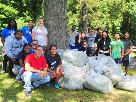 Kean University students help clear the shoreline at