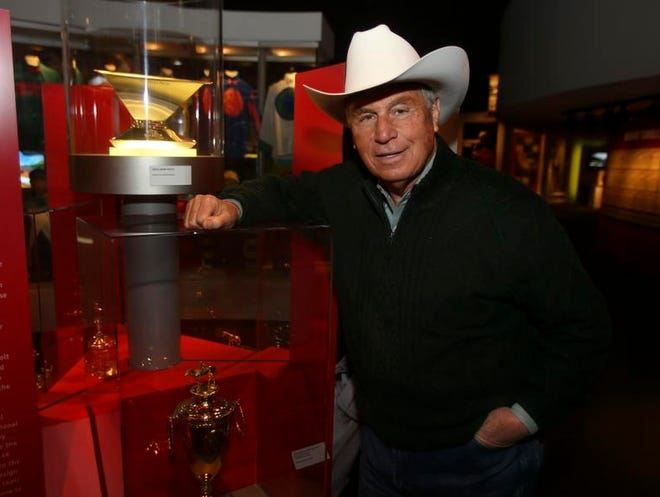 Trainer D. Wayne Lukas visits the Triple Crown trophy on display at the Kentucky Derby Museum. Lukas says that is the one dream he is still chasing.