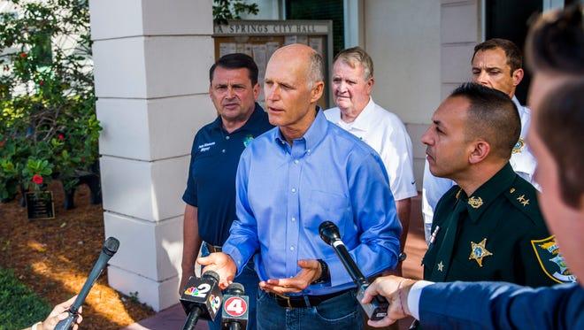 Gov. Rick Scott addresses members of the press at Bonita Springs City Hall on Friday, Sept. 1.