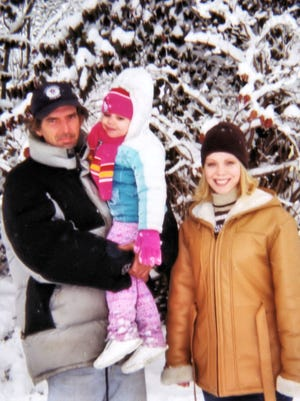 Michael Parsley with his daughter Jennifer Parsley Jones, right, and granddaughter Alicia in a family photo from 2002.