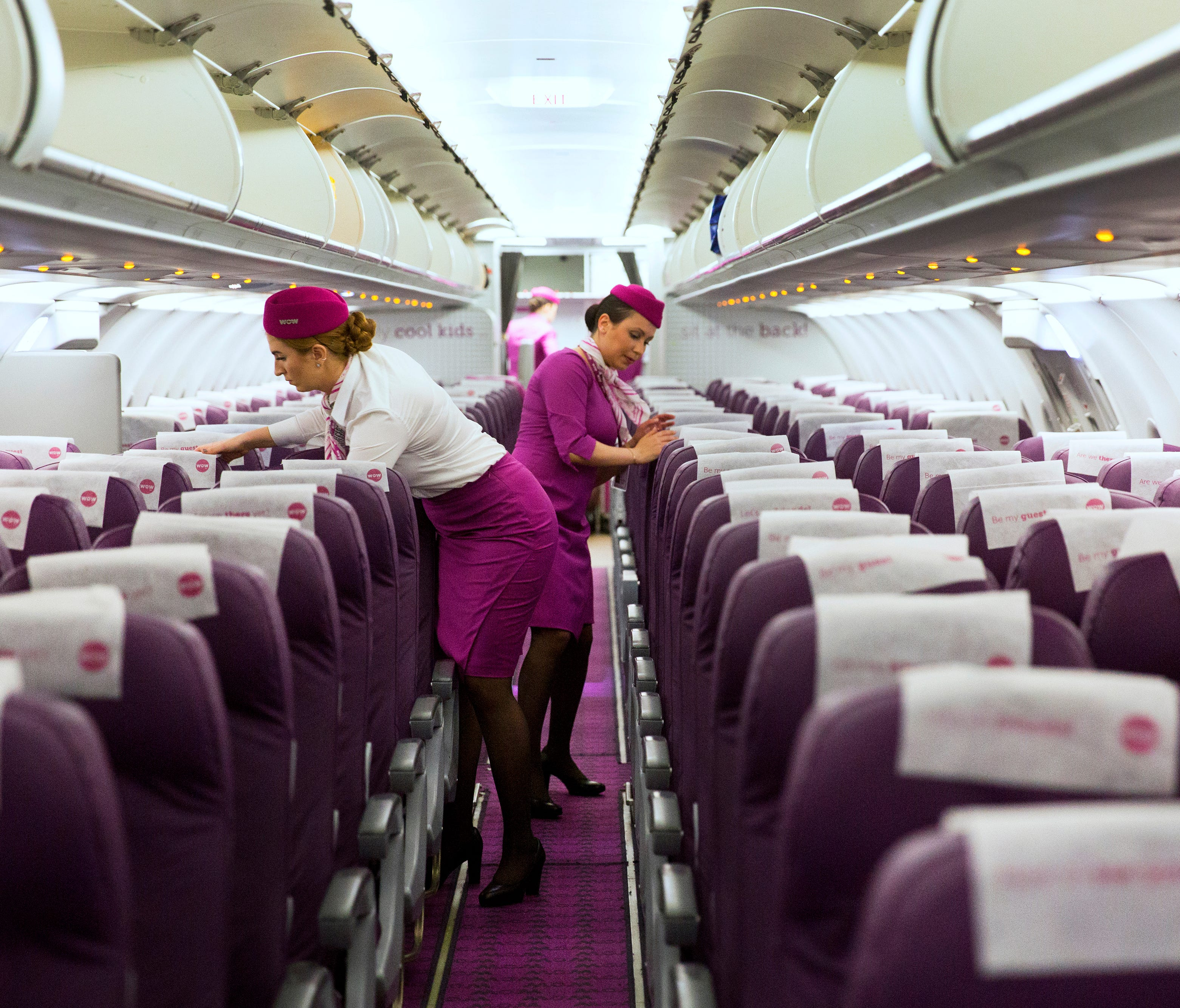 WOW Airlines celebrated their first flight from CVG on May 9. The plane took off for the five-and-a-half hour flight to Iceland at 12:50 am on May 10. So much purple! Flight attendants' uniforms are designed to be noticed. They embrace a vintage look