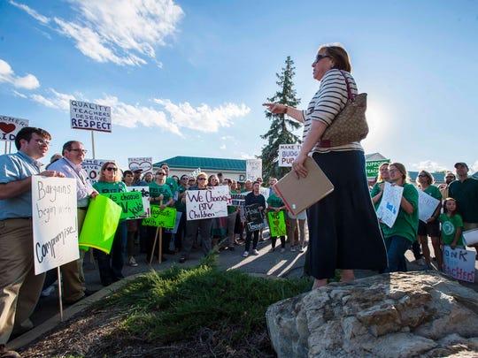 Teachers and their supporters listen as Fran Brock,