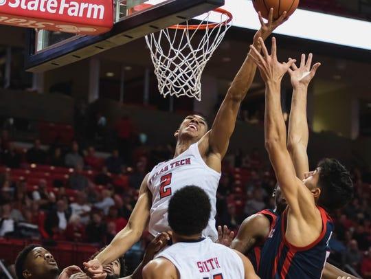 Texas Tech guard Zhaire Smith (2) battles for a rebound