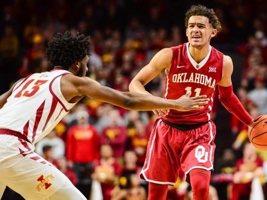 Oklahoma Sooners guard Trae Young (11) is defended by Iowa State Cyclones guard Jakolby Long (13) during the first half at James H. Hilton Coliseum.